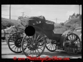 old-horseless-carriage-at-gasoline-station-near-2