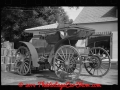 old-horseless-carriage-at-gasoline-station-near